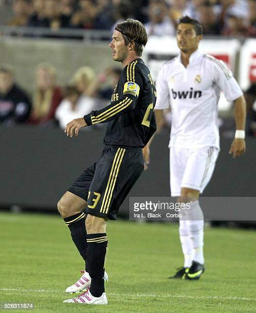 LA Galaxy player David Beckham and Real Madrid's Cristiano share the field during the Herbalife World Football Challenge Friendly match between LA...