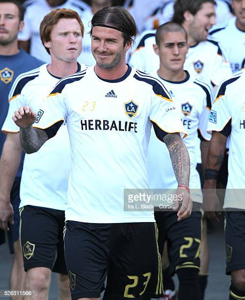 LA Galaxy player David Beckham leads the LA Galaxy team out for the Herbalife World Football Challenge Friendly match between LA Galaxy and Real...