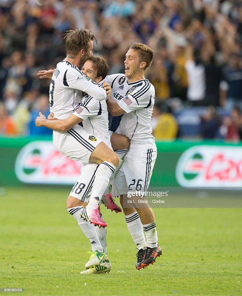 LA Galaxy player David Beckham Mike Magee and Michael Stephens celebrate after Landon Donovan's goal during the 2012 MLS Cup Championship Match...