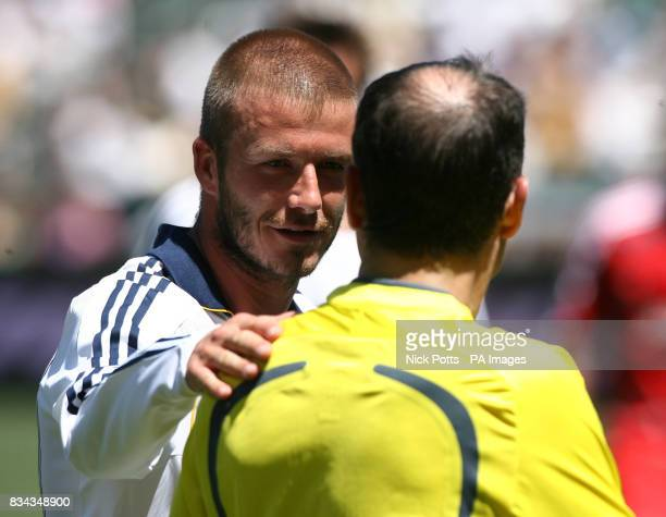 LA Galaxy's David Beckham puts an arm around a linesman during the Major League Soccer match at the Home Depot Center in Carson Los Angeles USA
