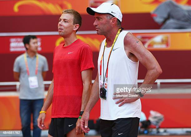 Galen Rupp of the United States and coach Alberto Salazar look on during a practice session ahead of the 15th IAAF World Athletics Championships...