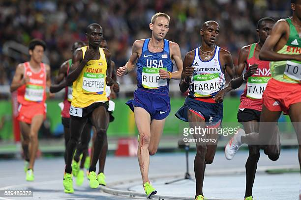 Galen Rupp of the United States and Mohamed Farah compete in the Men's 10000m on Day 8 of the Rio 2016 Olympic Games at the Olympic Stadium on August...