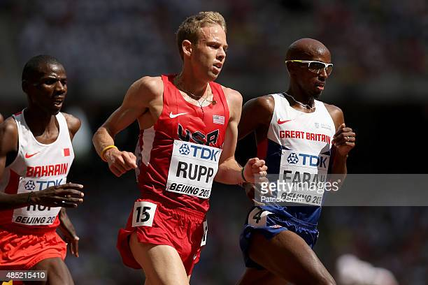 Galen Rupp of the United States and Mohamed Farah of Great Britain compete in the Men's 5000 metres heats during day five of the 15th IAAF World...