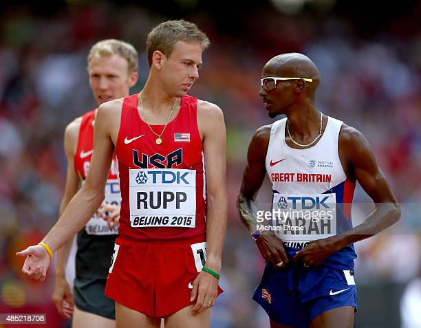 Galen Rupp of the United States and Mohamed Farah of Great Britain chat after competing iin the Men's 5000 metres heats during day five of the 15th...