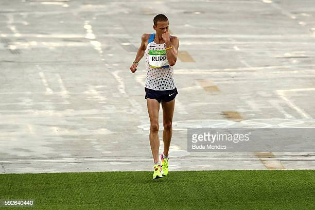 Galen Rupp of the United States celebrates as he crosses the line to win bronze during the Men's Marathon on Day 16 of the Rio 2016 Olympic Games at...