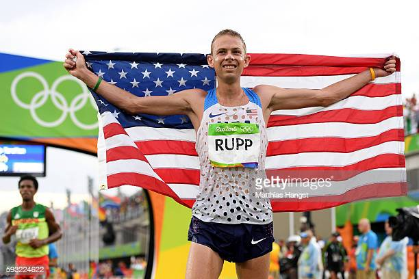 Galen Rupp of the United States celebrates as he wins bronze during the Men's Marathon on Day 16 of the Rio 2016 Olympic Games at Sambodromo on...