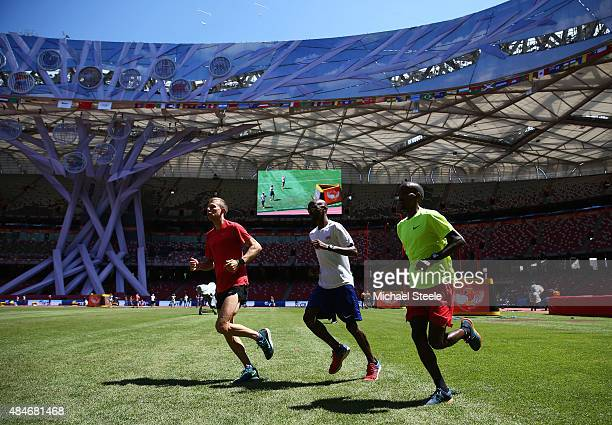 Galen Rupp of the United States Mo Farah of Great Britain and Belgian athlete Bashir Abdi during a practice session ahead of the 15th IAAF World...