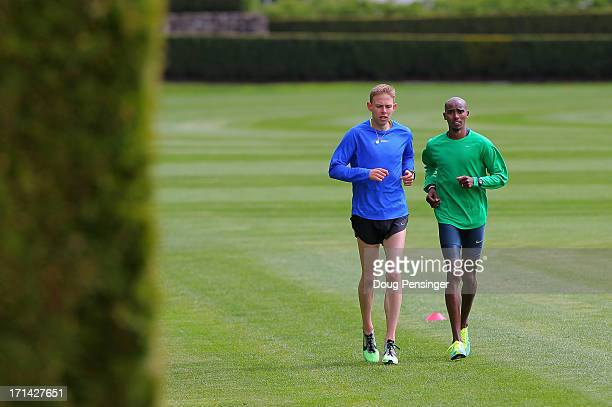 Galen Rupp of the USA and Mo Farah of Great Britain members of the Oregon Project train on the grass at the Nike campus on April 13 2013 in Beaverton...