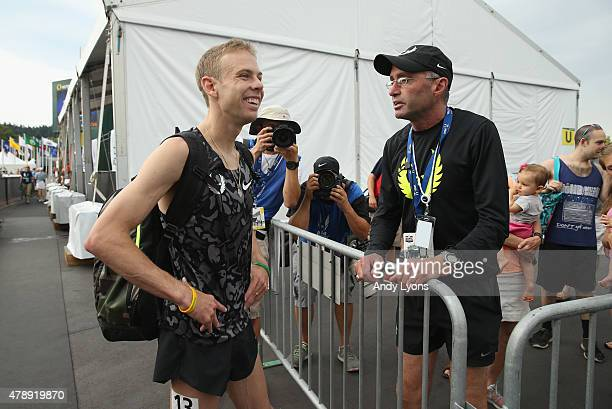 Galen Rupp talks with Alberto Salazar after the Mens 5000 Meter during day four of the 2015 USA Outdoor Track Field Championships at Hayward Field on...