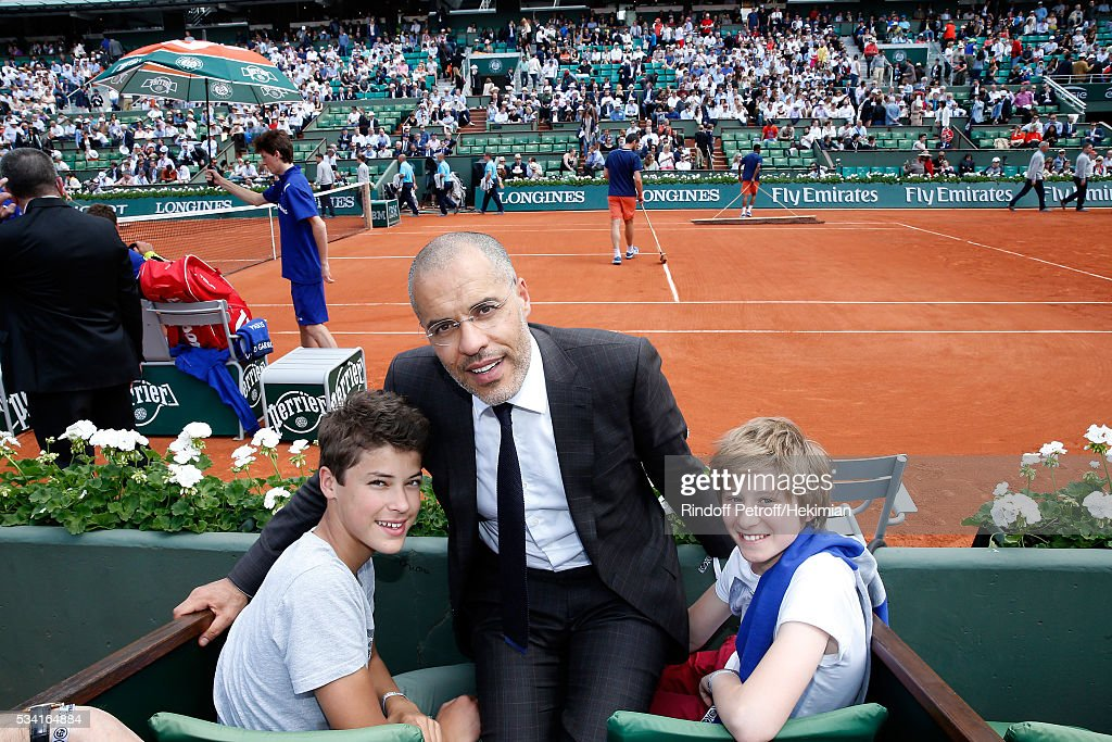 Galerist Kamel Mennour and sons attend the 2016 French Tennis Open - Day Four at Roland Garros on May 25, 2016 in Paris, France.