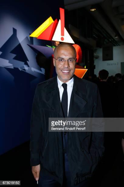 Galerist Kamel Mennour poses in front the works of JeanPaul Goude during the 'Societe des Amis du Musee d'Art Moderne du Centre Pompidou' Dinner...