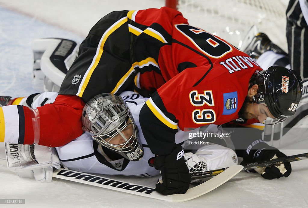 TJ Galiardi #39 of the Calgary Flames falls on goalie <a gi-track='captionPersonalityLinkClicked' href=/galleries/search?phrase=Jonathan+Quick&family=editorial&specificpeople=2271852 ng-click='$event.stopPropagation()'>Jonathan Quick</a> of the Los Angeles Kings during the first period of their NHL hockey game at the Scotiabank Saddledome February 27, 2014 in Calgary, Alberta, Canada.