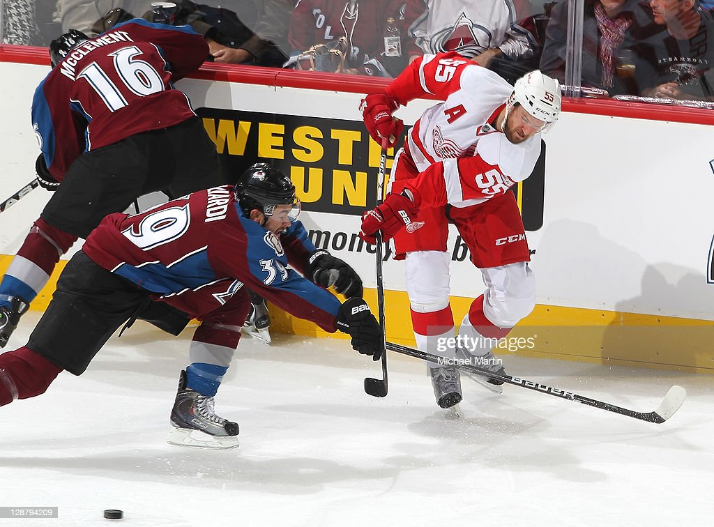 TJ Galiardi #39 of the Colorado Avalanche skates against <a gi-track='captionPersonalityLinkClicked' href=/galleries/search?phrase=Niklas+Kronwall&family=editorial&specificpeople=220826 ng-click='$event.stopPropagation()'>Niklas Kronwall</a> #55 of the Detroit Red Wings at the Pepsi Center on October 8, 2011 in Denver, Colorado.