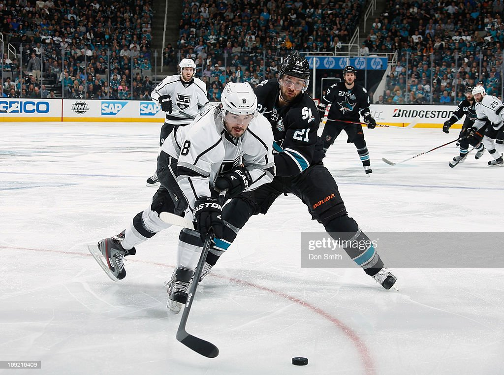 TJ Galiardi #21 of the San Jose Sharks battles for the puck against <a gi-track='captionPersonalityLinkClicked' href=/galleries/search?phrase=Drew+Doughty&family=editorial&specificpeople=2085761 ng-click='$event.stopPropagation()'>Drew Doughty</a> #8 of the Los Angeles Kings in Game Four of the Western Conference Semifinals during the 2013 Stanley Cup Playoffs at HP Pavilion on May 21, 2013 in San Jose, California.