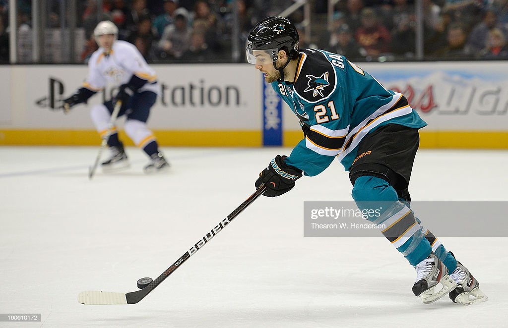 TJ Galiardi #21 of the San Jose Sharks skates with control of the puck against the Nashville Predators at HP Pavilion on February 2, 2013 in San Jose, California.