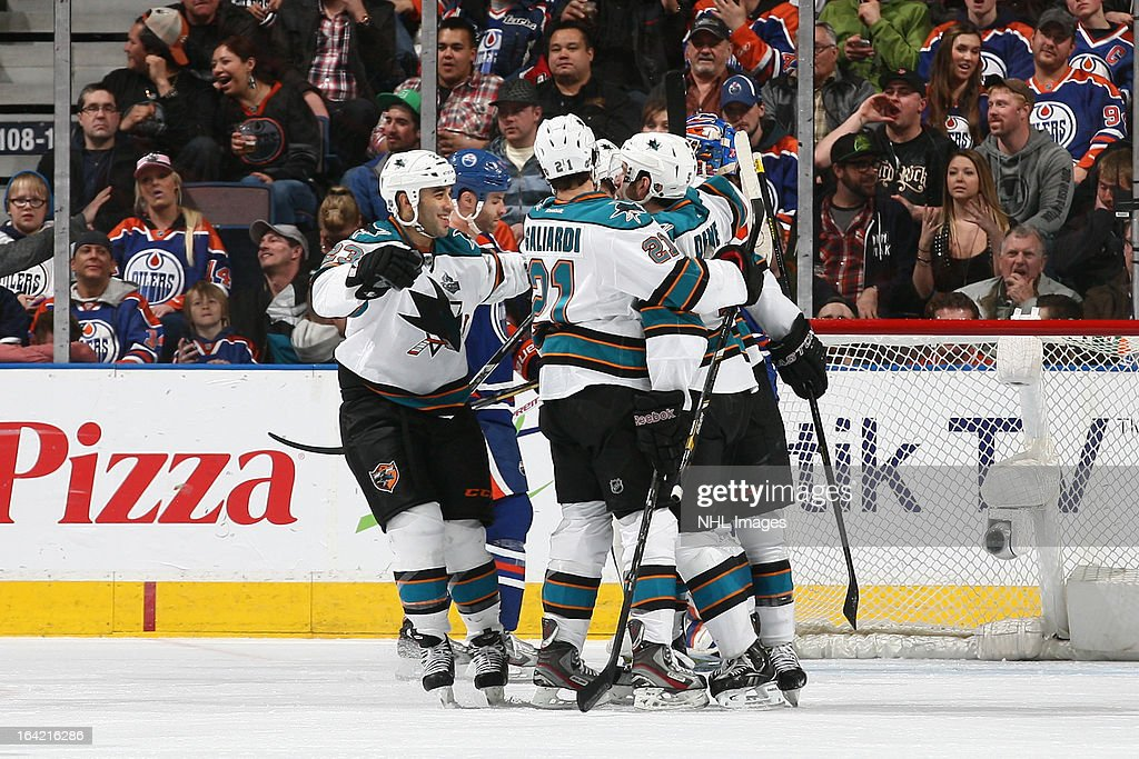 T.J. Galiardi #21, Scott Gomez #23 and Jason Demers #5 of the San Jose Sharks celebrate after scoring late in the third period against the Edmonton Oilers on March 20, 2013 at Rexall Place in Edmonton, Alberta, Canada.