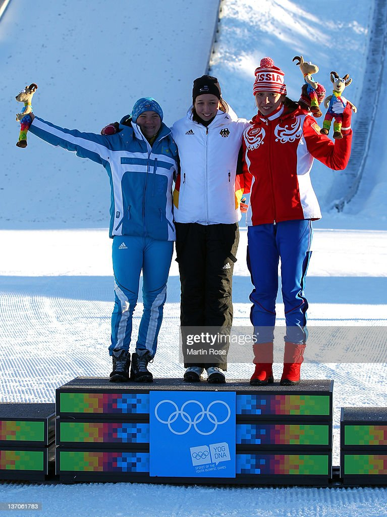 <a gi-track='captionPersonalityLinkClicked' href=/galleries/search?phrase=Galina+Vishnevskaya&family=editorial&specificpeople=911029 ng-click='$event.stopPropagation()'>Galina Vishnevskaya</a> of Kazakhstan (Silver), Franziska Preuss of Germany (Gold) and Uliana Kaysheva of Russia (Bronze) celebrate at the Biathlon women's 6km sprint race during the Winter Youth Olympic Games at Seefeld Arena on January 15, 2012 in Seefeld, Austria.