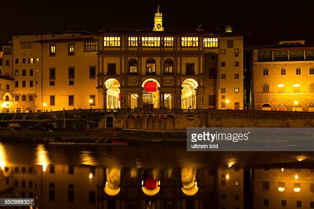 Galleria degli Uffizi illuminated at Night reflecting in the Arno River Florence Italy