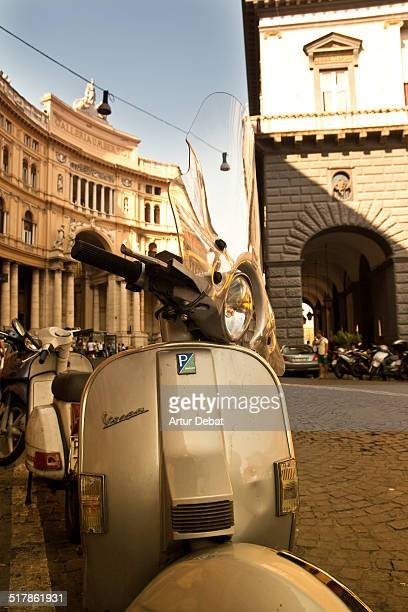 Galleria Umberto façade building with Vespa motorbike in the streets of Naples Italy Europe