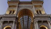Galleria Vittorio Emanuele II entrance illuminated -  Milano (Italy) - October 30, 2017.