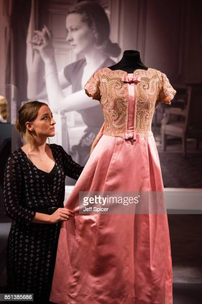 A gallery assistant adjusts a Victor Stiebel pink full length evening dress during the press call for the Vivien Leigh auction at Sotheby's on...