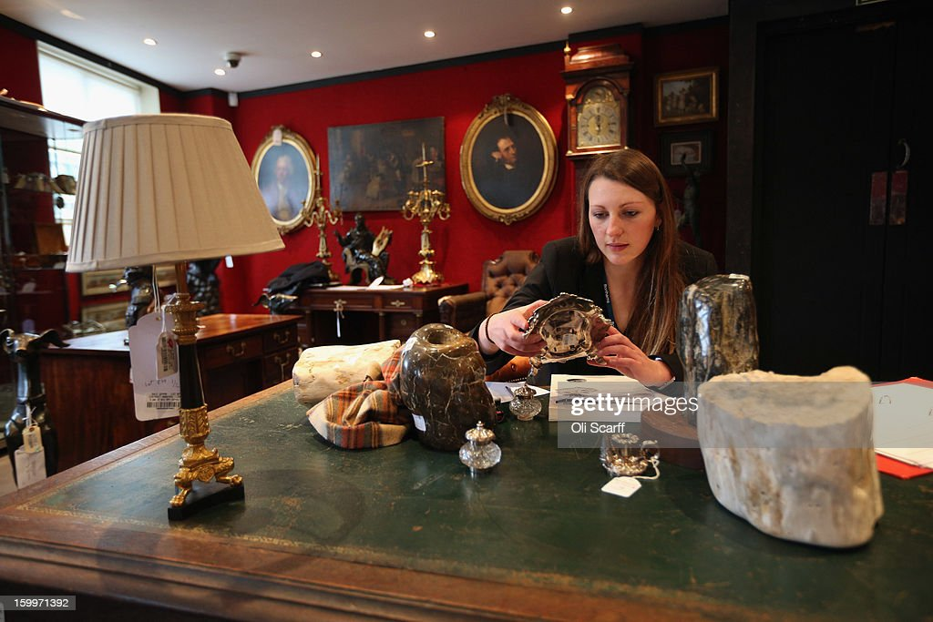 A gallery assistant at Bonhams auction house compiles a condition report on lots for sale in their forthcoming 'Gentleman's Library Sale', on January 24, 2013 in London, England. The auction includes an eclectic mix of rare items such as a pygmy hippo skeleton, a cigar that belonged to Winston Churchill and a MI9 spy catalogue. It will take place in Bonhams Knightsbridge on January 29 and 30, 2013.