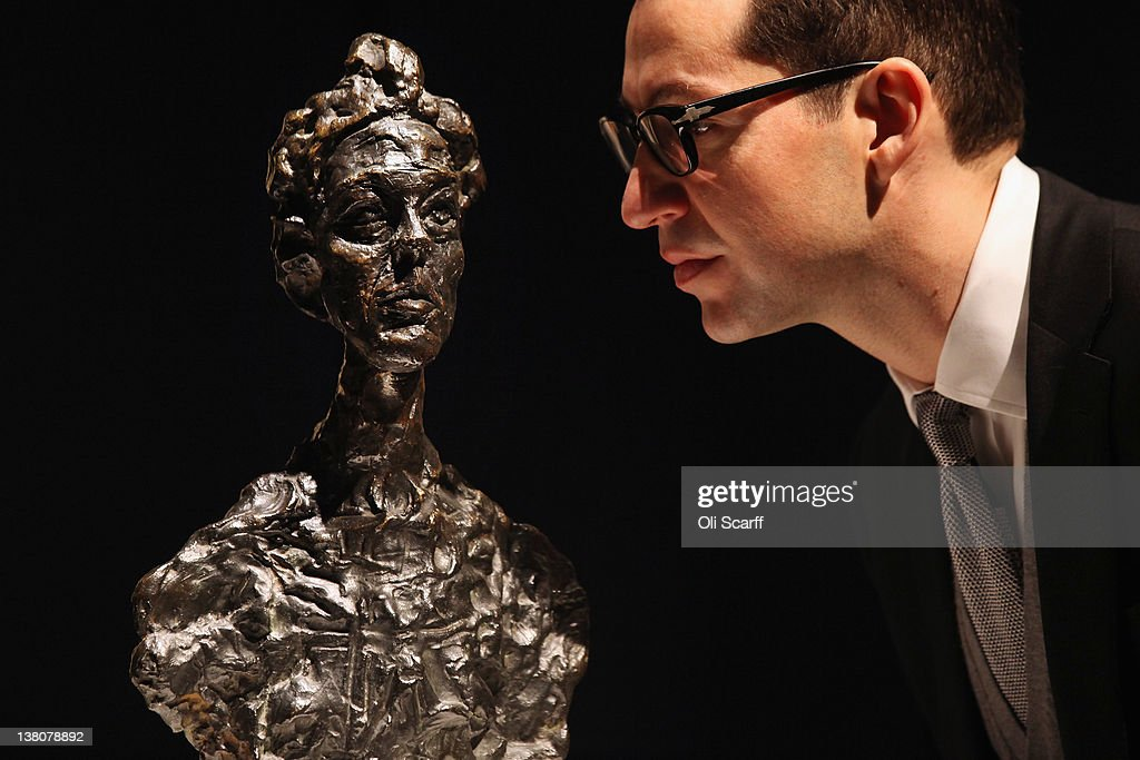 A gallery assistant at Christie's auction house admires a sculpture by Alberto Giacometti entitled 'Annette Venise' on February 2, 2012 in London, England. The artwork, which is estimated to fetch 1.5 million GBP, is being auctioned in Christie's forthcoming evening sales of 'Impressionist and Modern Art' and 'Art of the Surreal' which will take place between February 7, 2012 and February 9, 2012.