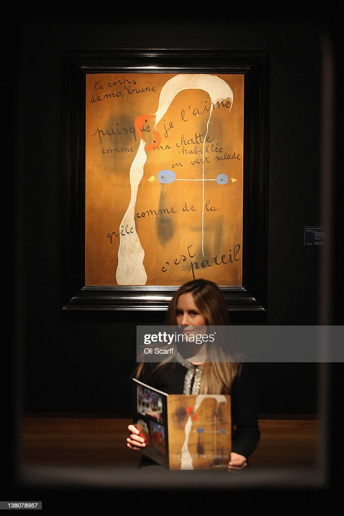 A gallery assistant at Christie's auction house sits in front of a painting by Joan Miro entitled 'Painting-Poem' on February 2, 2012 in London, England. The artwork, which is estimated to fetch 9 million GBP, is being auctioned in Christie's forthcoming evening sales of 'Impressionist and Modern Art' and 'Art of the Surreal' which will take place between February 7, 2012 and February 9, 2012.