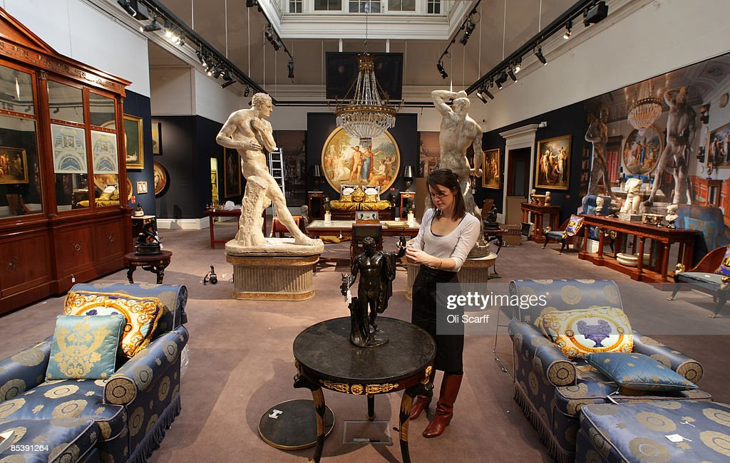 A Gallery Assistant At Sothebyu0027s Auction House Examines A Statue Included  In The Forthcoming Sale Of