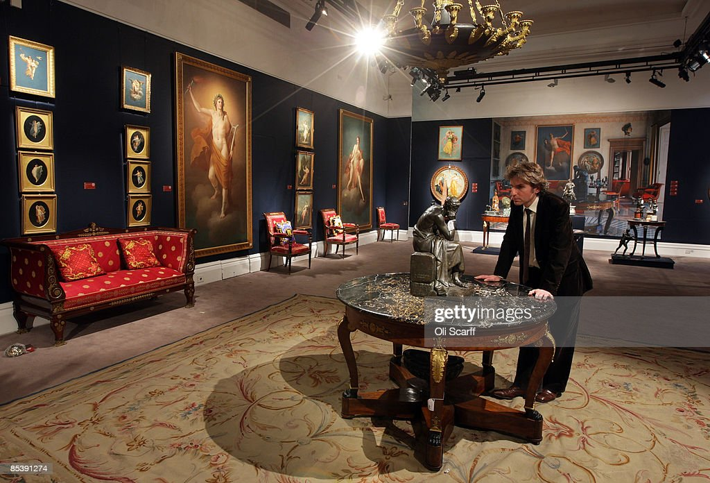A gallery assistant at Sotheby s auction house examines a statue included  in the forthcoming sale of. Sotheby s Prepare To Auction The Interiors Of Versace s Lake Como