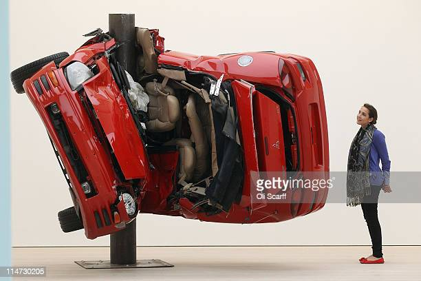 A gallery assistant at the Saatchi Gallery admires a sculpture by artist Dirk Skreber entitled 'Untitled ' on May 26 2011 in London England The...