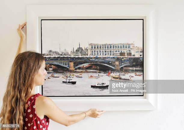 Gallery assistant Emily ActonEdmiston adjusts River Pageant 3 by artist David PorteousButler as more than fifty works of art inspired by the Thames...