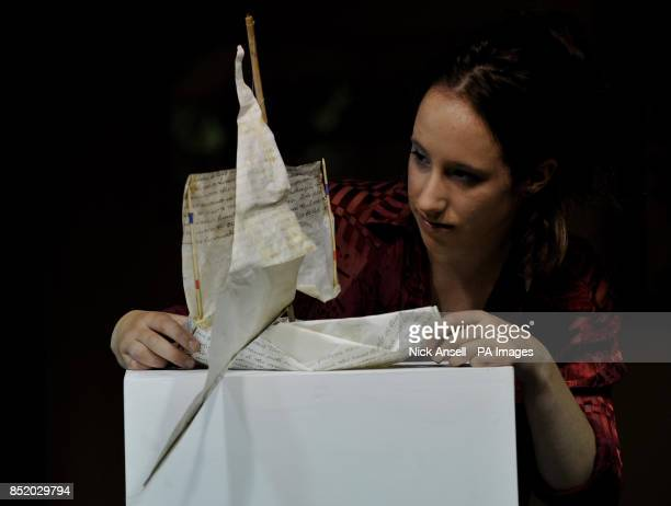 Gallery assistant Polly Millner adjusts Pageant Boat made from an old Will written on Velum by artist Edmund Prizeman as more than fifty works of art...