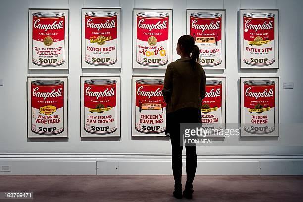 A gallery assistant poses in front of Andy Warhol's 'Campbell's Soup' estimated to fetch between 150000 200000 GBP at Sotheby's auction house in...