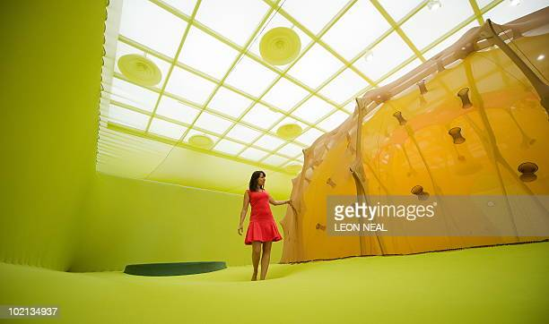 A gallery assistant walks on the stretched scrim material that makes up 'Horizonmembranenave' by Brazilian artist Ernesto Neto at the Hayward Gallery...