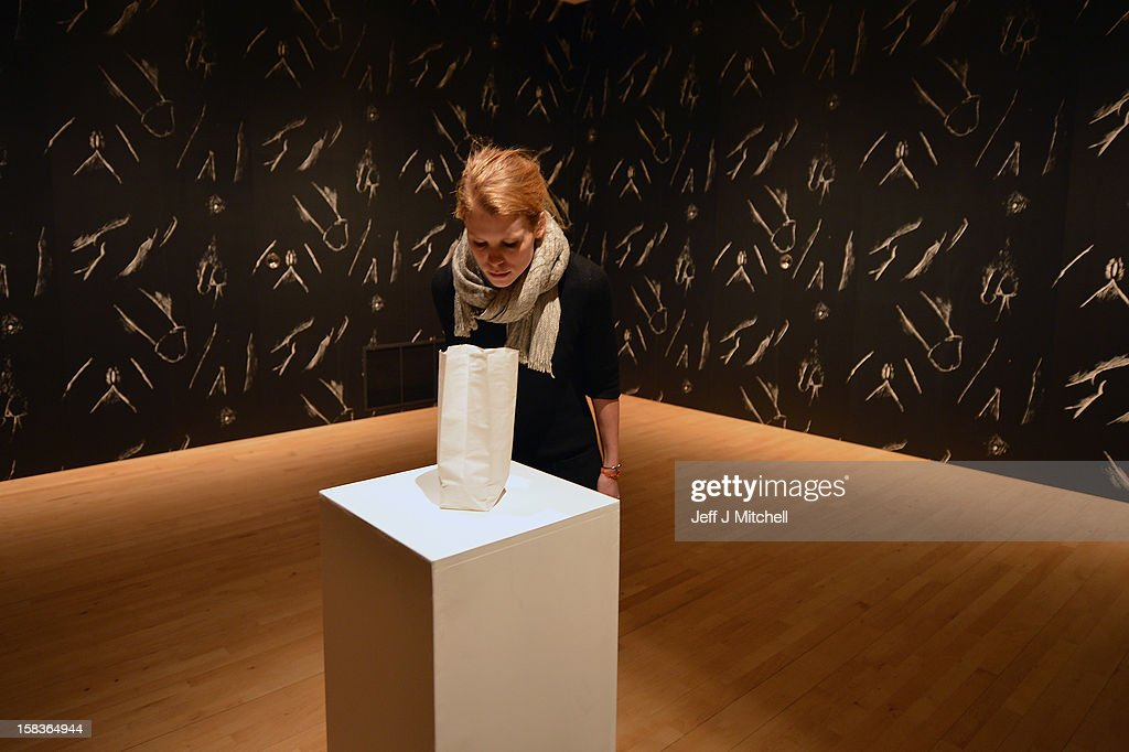 A gallery assistant walks past 'Male and Female Genital Wallpaper' by Robert Gober at the The Scottish National Gallery of Modern Art on December 14, 2012 in Edinburgh, Scotland. The gallery has announced a major exhibition running from the 15th of December to the 8th of September 2013, bringing together works from the D. Daskalopoulos Collection, one of the most important collections of contemporary art with major works from the Scottish national collection. The innovative exhibition, curated by Keith Hartley, Chief Curator at the Scottish National Gallery of Modern Art, comprises over 120 works and will create a new and dynamic context for both collections.