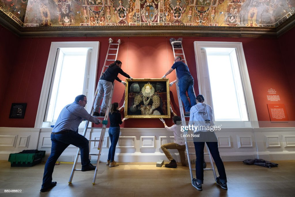 Gallery assistants pose with the 'Armada Portrait of Elizabeth I' oil painting as it is unveiled following extensive cleaning at the Queen's House, Greenwich on October 12, 2017 in London, England. Painted in the early 1590s, the uncredited painting was aquired for the nation in 2016 and has since undergone lengthy conservation to restore the work to it's original colours.