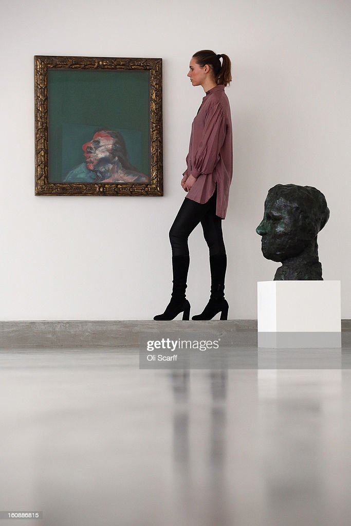 A gallery employee admires a painting by British artist Francis Bacon entitled 'Miss Muriel Belcher' and a sculpture by French artist Auguste Rodin entitled 'Iris, Grosse Tete' at Ordovas gallery on February 7, 2013 in London, England. It is the first time Bacon's 1967 painting 'Three Studies From The Human Body', has gone on public display in the UK.The artwork features in an exhibition entitled 'Movement And Gravity: Bacon And Rodin In Dialogue' which runs from February 8, 2013 until April 6, 2013.