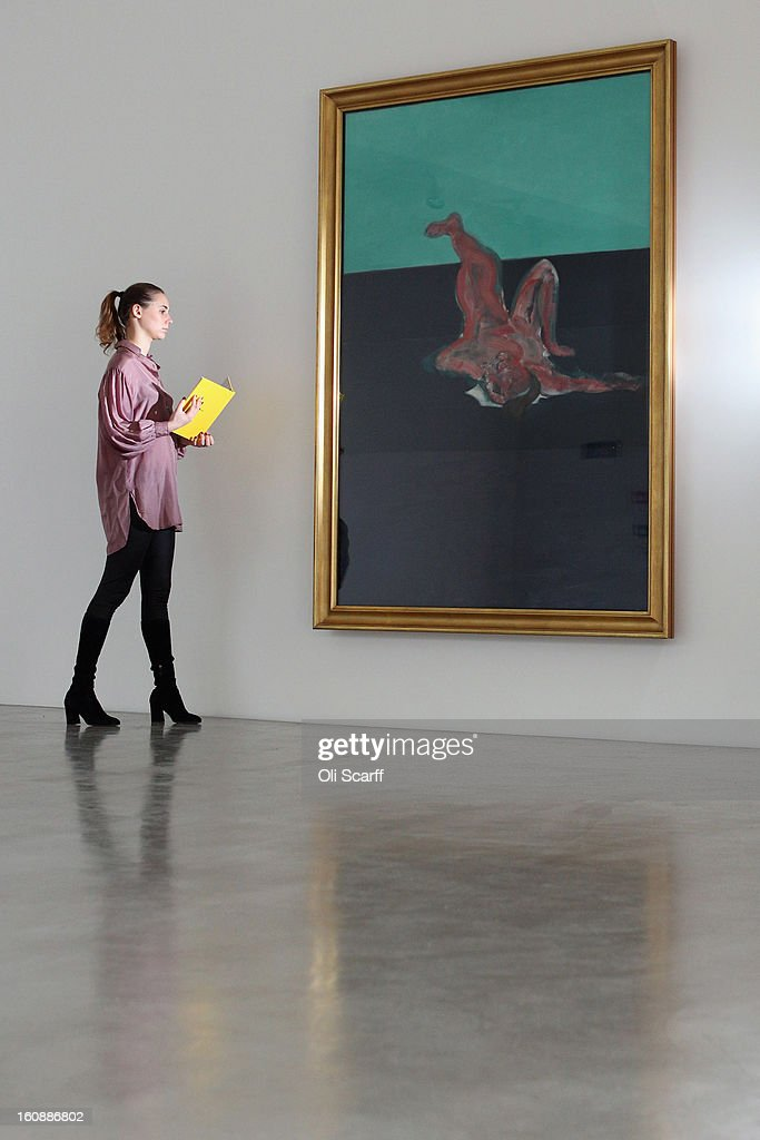 A gallery employee admires a painting by Francis Bacon entitled 'Lying Figure' at Ordovas gallery on February 7, 2013 in London, England. It is the first time Bacon's 1967 painting 'Three Studies From The Human Body', has gone on public display in the UK.The artwork features in an exhibition entitled 'Movement And Gravity: Bacon And Rodin In Dialogue' which runs from February 8, 2013 until April 6, 2013.