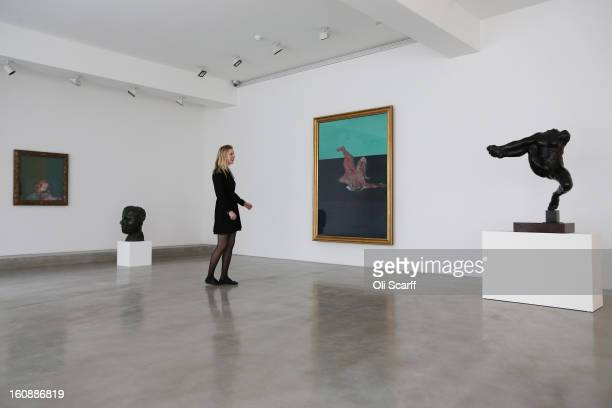 A gallery employee admires paintings by Francis Bacon and sculptures by Auguste Rodin at Ordovas gallery on February 7 2013 in London England It is...