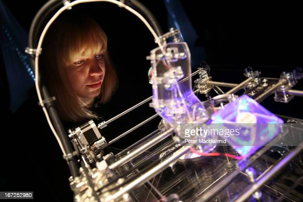 Gallery employee Rosalind Leake looks at a 3D printer at the 'Insects au Gratin' exhibition at the Wellcome Collection on April 23 2013 in London...