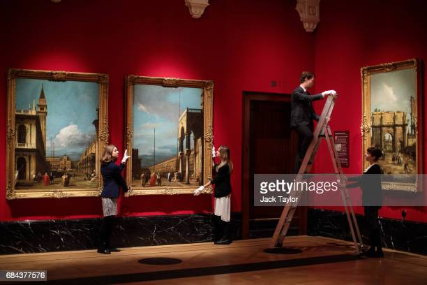 Gallery employees pose with works from Canaletto's views of Venice painted between 17231724 and a painting from his set of Roman views from 1742 at...