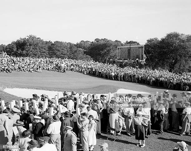 A gallery gathers with periscopes during the 1953 Masters Tournament at Augusta National Golf Club in April 1953 in Augusta Georgia
