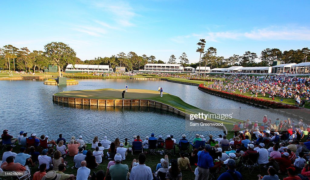 A gallery of fans watch <a gi-track='captionPersonalityLinkClicked' href=/galleries/search?phrase=Tiger+Woods&family=editorial&specificpeople=157537 ng-click='$event.stopPropagation()'>Tiger Woods</a> of the United States putt on the 17th green during the second round of THE PLAYERS Championship held at THE PLAYERS Stadium course at TPC Sawgrass on May 11, 2012 in Ponte Vedra Beach, Florida.