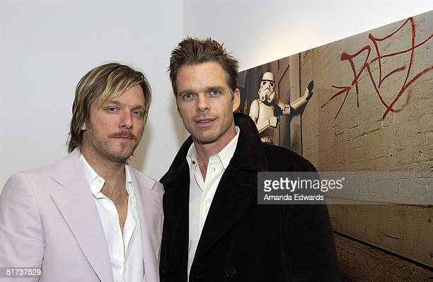 Gallery owner Kelly Cole and actor Josh Coxx attend the 'Superfamous' Photographs by Michael Muller party on November 12 2004 at the LoFi gallery in...