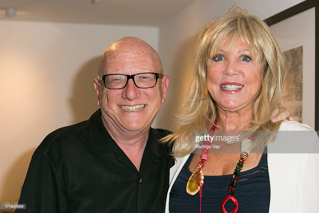 Gallery owner Rich Horowitz (L) and photographer Pattie Boyd attend the Pattie Boyd: Newly Discovered Photo Exhibition at Morrison Hotel Gallery on June 28, 2013 in West Hollywood, California.