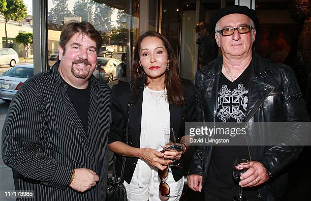 Gallery owner Trigg Ison actress/artist Barbara Carrera and photographer Robert M Knight attend the Trigg Ison Fine Arts Gallery's new location...