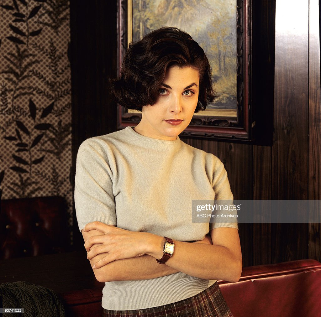 PEAKS - Gallery - Season One - , Homecoming queen Laura Palmer is found dead, washed up on a riverbank wrapped in plastic sheeting and FBI Special Agent Dale Cooper is called in to investigate the gruesome murder in the small Northwestern town of Twin Peaks. Pictured: Sherilyn Fenn stars as Audrey Horne the teenage daughter of a wealthy businessman.,
