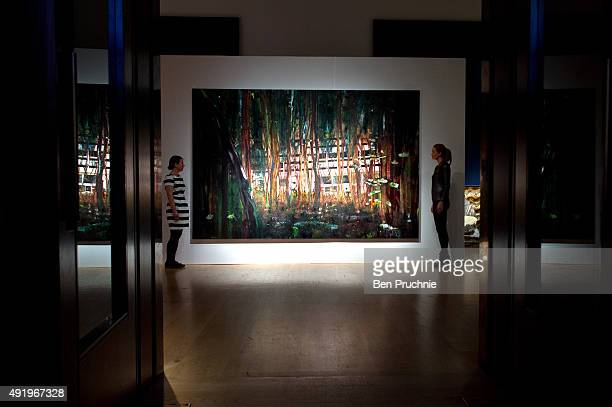Gallery staff view 'Cabin Essence' by artist Peter Doig during the preview ahead of Christie's London post war and contemporary art sale next week on...