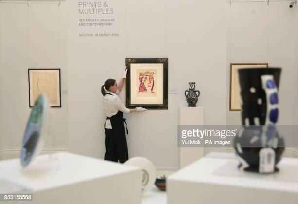 Gallery technician Jodie Francis inspects Pablo Picasso's Portrait de Jacqueline au Chapeau de Paille Multicolore which will go on sale along with...